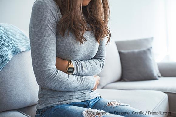 Kontraindikation für Spirale: Frau mit Menstruationsbeschwerden
